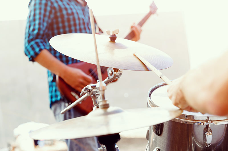man playing drums at an event